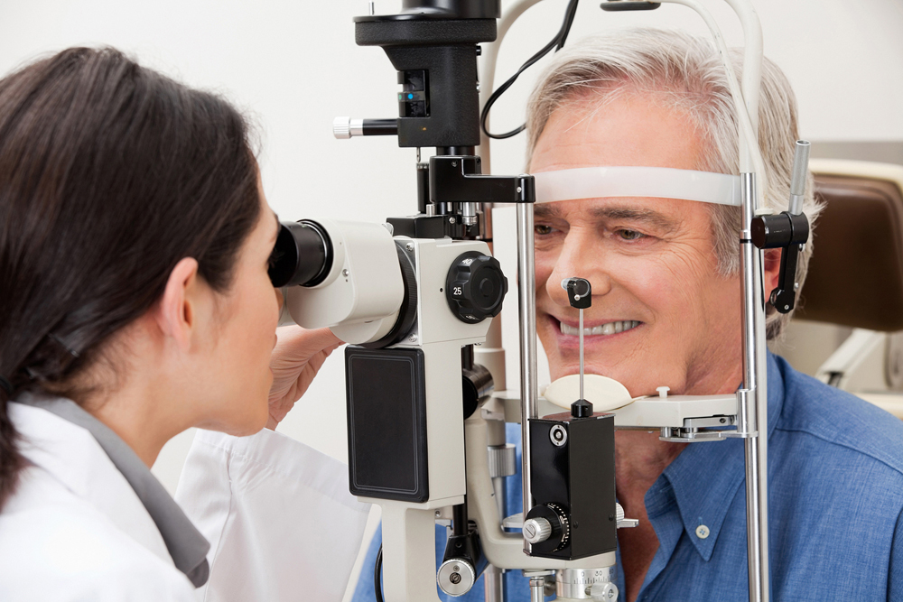 Man getting checked for eye diseases in Hamilton, ON.